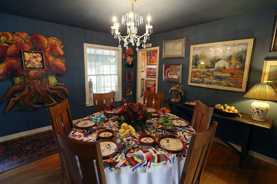 The blue-painted dining room is the site of the Lanes' numerous dinner parties and, of course, more art.