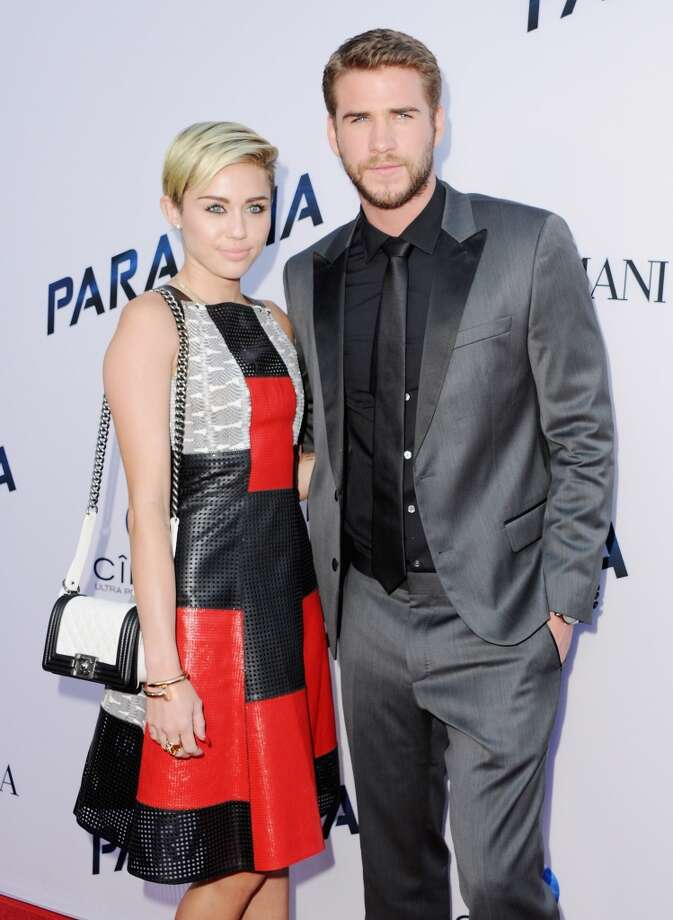 "Singer Miley Cyrus and actor Liam Hemsworth arrive at the Los Angeles Premiere ""Paranoia"" at DGA Theater on August 8, 2013 in Los Angeles, California. Photo: Jon Kopaloff, FilmMagic"