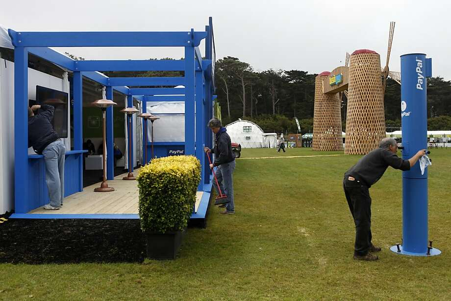 Workers set up the Pay Pal store at the opening day of the Outside Lands Festival at Golden Gate Park in San Francisco, Calif. on Friday, August 9, 2013. Photo: Katie Meek, The Chronicle