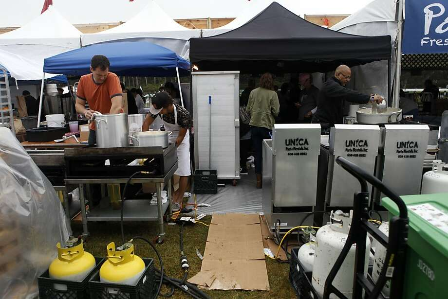 Workers at food trucks prepare meals for the opening day of the Outside Lands Festival at Golden Gate Park in San Francisco, Calif. on Friday, August 9, 2013. Photo: Katie Meek, The Chronicle