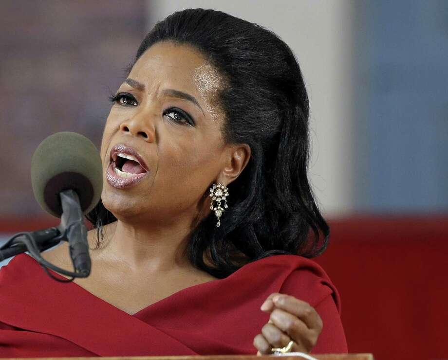 "FILE - In this May 30, 2013 file photo, Oprah Winfrey speaks during Harvard University's commencement ceremonies in Cambridge, Mass. Winfrey says she had a racist encounter while shopping in Switzerland _ and the apologetic national tourist office agrees. The billionaire media mogul told the U.S. program ""Entertainment Tonight"" that a shop assistant in Zurich refused to show her black handbag because it was ""too expensive"" for her. She was in town to attend last month's wedding of her longtime pal Tina Turner, who lives in a Swiss chateau along Lake Zurich. Forbes magazine estimates that Winfrey earned $77 million in the year ending in June. Photo: Elise Amendola"