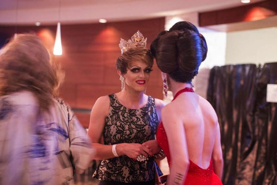 Two queens share a moment during a drag competition at Club Meteor Photo: © TODD SPOTH PHOTOGRAPHY, LLC