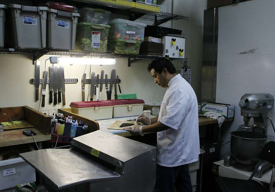 Jorge Flores works at Don Polvoron Bakery in Hayward. The business now employs nine people and hopes to grow. Photo: Paul Chinn, The Chronicle