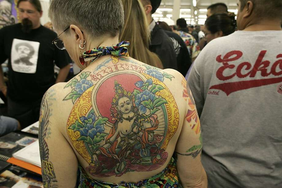 "tattoo_213_mac.jpg       Linda May Ellis, of Boston, Ma.,  circulates through the crowded hall with her Marcus Khun tattoo across her entire back. Thousands of tattoo and piercing exhibitors from around the country descend on the Cow Palace in Daly City for the, ""Body Art Expo"".   8/27/05  Daly City, Ca   Michael Macor / San Francisco Chronicle   Ran on: 08-28-2005 Keith Marymont of Pacifica goes under the needle of Jeff Pickens, a Daly City tattoo artist, at the convention.  Ran on: 08-28-2005 Keith Marymont of Pacifica goes under the needle of Jeff Pickens, a Daly City tattoo artist, at the convention. Photo: Michael Macor, SFC"