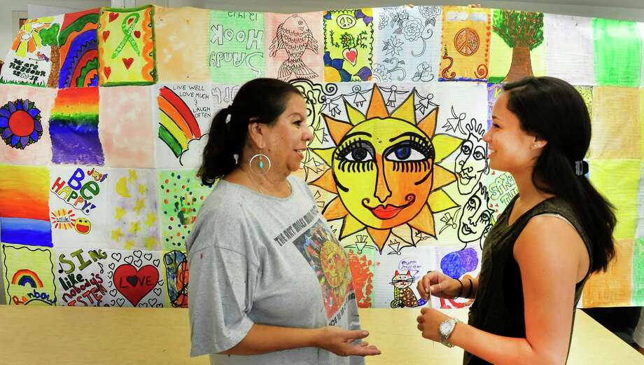Joanne Tawfilis, of the United States National Commision for UNESCO, left, talks with Alex Scarpa, of Sandy Hook, as the Art Miles Mural Project visits Newtown Congregational Church, Thursday, Aug. 8, 2013. Newtown, Conn., residents are creating a mural that will hang in the United Nations building Sept. 21, the International Day of Peace. Photo: Michael Duffy / The News-Times