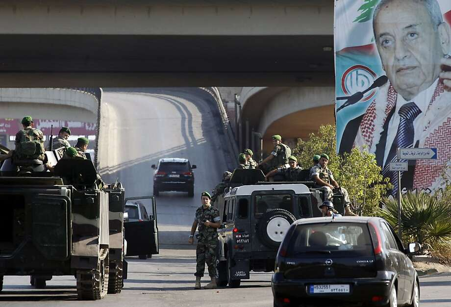 Lebanese army troops patrol the airport highway on the southern outskirts of Beirut after the kidnapping at gunpoint of two pilots from a bus carrying Turkish Airlines personnel. Photo: Anwar Amro, AFP/Getty Images