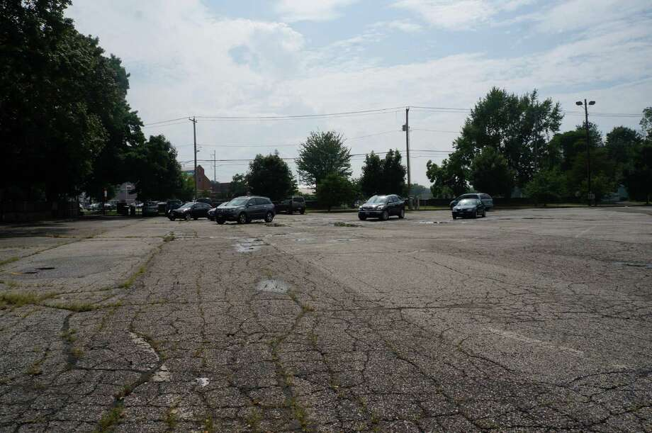 Shuttle service from the satellite train station parking lot on Mill Plain Road has been discontinued. There were 12 cars parked in the lot on a recent Friday. Photo: Genevieve Reilly / Fairfield Citizen