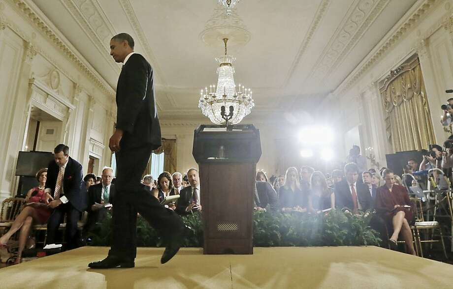 President Obama ends a news conference at the White House on oversight  of the National Security Agency and its controversial surveillance programs. Photo: Pablo Martinez Monsivais, Associated Press