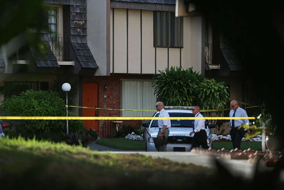 Authorities investigate at the South Miami, Fla., home where Jennifer Alfonso was found dead. Photo: Joe Raedle, Getty Images
