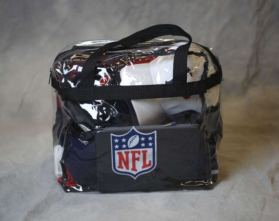 A new NFL regulation clear plastic bag, packed with items that a fan might bring to a game. Photo: ( Karen Warren / Houston Chronicle )