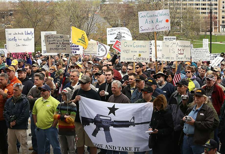 Gun rights activists gather during a gun rights rally at the Connecticut State Capitol in Hartford Conn. on Saturday April 20, 2013.  The Connecticut Citizens Defense League , the National Rifle Association and Coalition of Connecticut Sportsmen are joining forces to challenge the new gun control legislation recently passed by the Connecticut General Assembly after the Newtown school shooting. Among other things, the law expands Connecticut's assault weapons ban and bans large capacity ammunition magazines. (AP Photo/Journal Inquirer, Jared Ramsdell)  MANDATORY CREDIT Photo: Jared Ramsdell, Associated Press