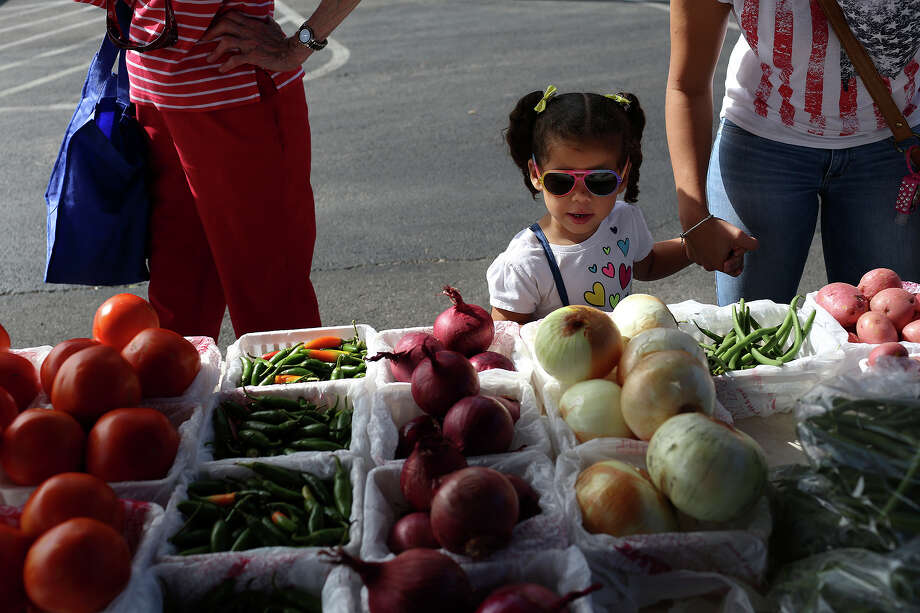 Thursday (only 2nd and 4th of the month) - San Antonio Housing AuthorityMarch to December10 a.m. until 1 p.m. 818 S. Flores St., San Antonio, TX,     78204   Website: SAHA Farmers' Market  (Photo is from farmer's market at St. Matthew Catholic Church.) Photo: Lisa Krantz, San Antonio Express-News / San Antonio Express-News