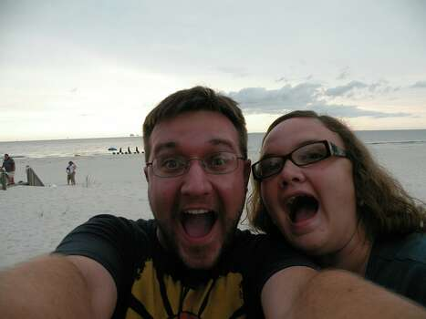 This was taken in Fort Morgan Beach Alabama. We were on vacation with 12 other family members. As you can see, we were very excited to be there!