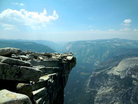 This picture was taken at Yosemite National Park - Half Dome - on July 29th, 2013. My friend and I obtained our lottery permit in April to hike Half Dome. We started the hike at 6am and reached the summit (elevation of 8,836 ft) at noon. It took us roughly 12 hours or 14 miles roundtrip from Yosemite Valley to the top of Half Dome. It was a great experience and definitely appreciate the beautiful environment right here in the USA!