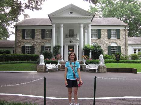 "Graceland.  Memphis, Tennessee.  Home of Elvis Presley ""The King of Rock 'n' Roll.""  My daughter and I toured Graceland on July 30th.  We loved the 70's theme, especially the TV room with the three television sets.