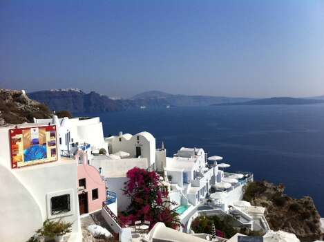 Santorini, Greece.  My husband and I had been shopping.  We stopped to enjoy a cold Mykos beer and this was our view.