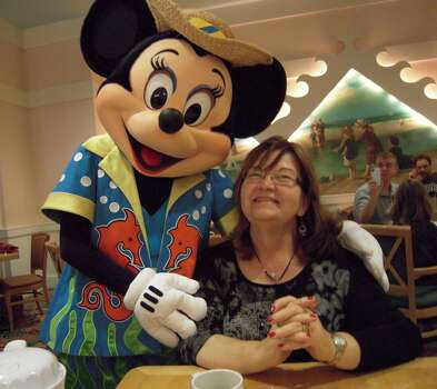 My wife and Minnie at Yacht and Beach Club for breakfast at Christmas in 2011. We are Disney nuts and have been to Disney World nine times since 1987. It's more fun without the kids!