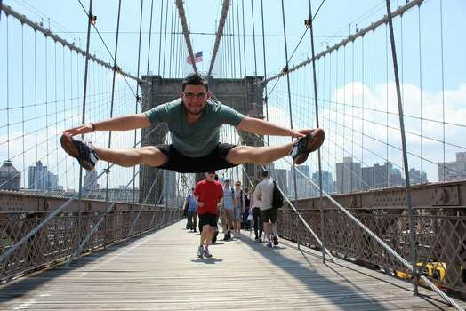 This photo was taken on the Brooklyn Bridge in NYC!!!    I actually had just gotten home from a 2 year backpacking trip around the world, but it was a much needed vacation.     I have a travel blog to document my life/travels and during my 2 year trip around the world I visited many iconic sites and would take a Toe Touch photo at each of them. I was featured on Mashable, GMA, Yahoo, ABC, NBC & many other outlets. Here all 52 Toe Touches I took around the world: http://breakawaybackpacker.com/2013/05/toe-touch-photos/     I'm happy to be home in Houston and spending time with friends and family but am also now working and saving to take off again (I pay for my own travels) and see more of this beautiful world!!!