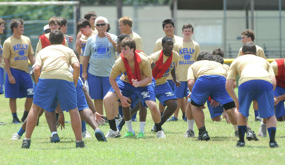 Bulldog players run drills and plays at Kelly's practice field Friday.  Photo taken Friday, August 09, 2013 Guiseppe Barranco/The Enterprise Photo: Guiseppe Barranco, STAFF PHOTOGRAPHER / The Beaumont Enterprise