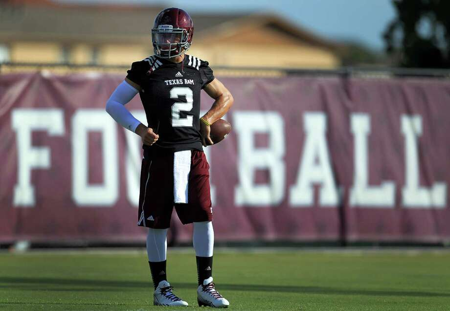 Texas A&M quarterback and Heisman Trophy winner Johnny Manziel is back on the practice field after a controversial offseason. Photo: Karen Warren, Staff / © 2013 Houston Chronicle