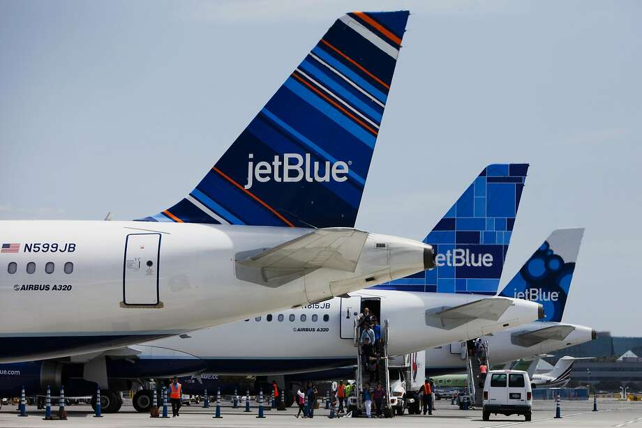 Passengers exit a JetBlue Airways Corp. plane at Long Beach Airport (LGB) in Long Beach, California, U.S., on Monday, July 22, 2013. JetBlue Airways Corp. is scheduled to release earnings figures on July 30. Photographer: Patrick T. Fallon/Bloomberg Photo: Patrick T. Fallon, Bloomberg