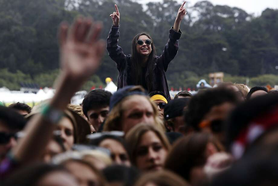A fan cheers while Band of Horses plays the Lands End stage during the first day of the Outside Lands music festival in Golden Gate Park in San Francisco, Calif. on August 9, 2013. Photo: Ian C. Bates, The Chronicle