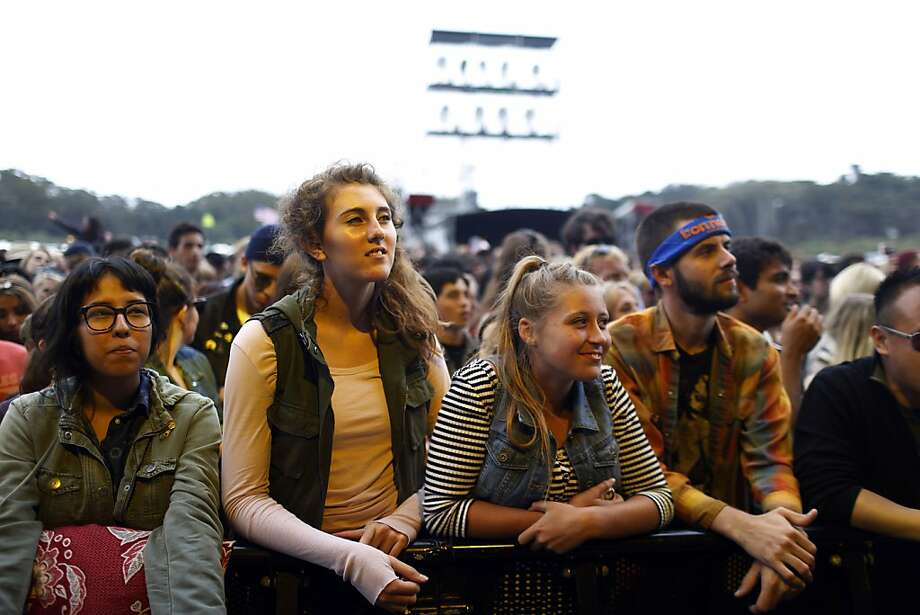 Fans are lit by stage lights during the Band of Horses show during the first day of the Outside Lands music festival in Golden Gate Park in San Francisco, Calif. on August 9, 2013. Photo: Ian C. Bates, The Chronicle