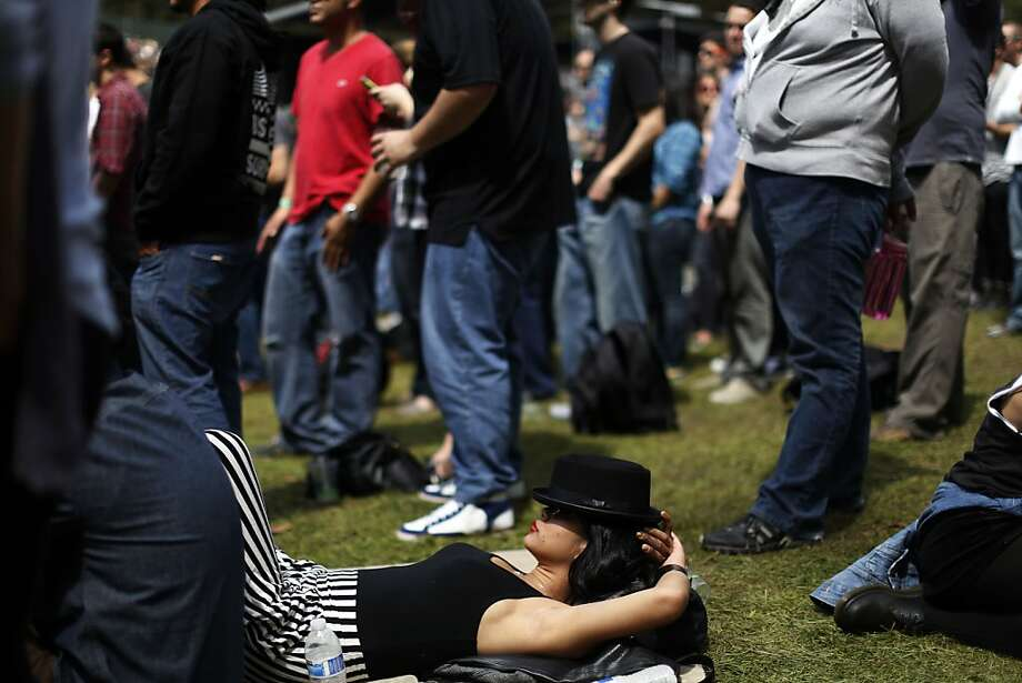 A fan lays down while listening to The Heavy on the Sutro stage during the first day of the Outside Lands music festival in Golden Gate Park in San Francisco, Calif. on August 9, 2013. Photo: Ian C. Bates, The Chronicle