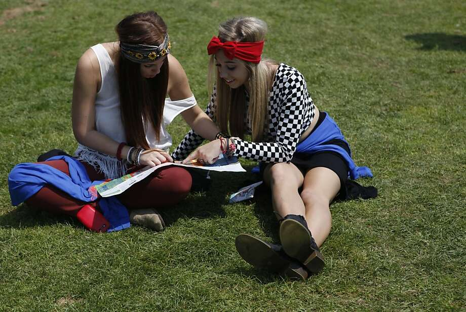 Nichole Uribe and Alyssa Kasher study their map and make a plan of what shows to see at the Outside Lands Festival in San Francisco, Calif. on Friday, August 9, 2013. Photo: Katie Meek, The Chronicle