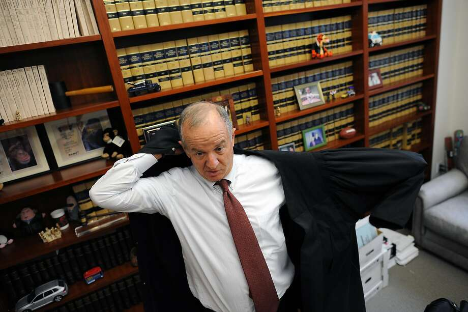 San Francisco Superior Court Judge Richard Kramer pulls on his robe in his office during a break in a civil trial he is presiding over in his courtroom in San Francisco, California Wednesday, August 7, 2013. Photo: Michael Short 2013, Special To The Chronicle