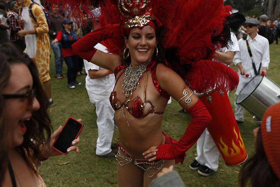 Tica Bonita, preformer with the Samba Stilt Circus, dances with people at the Outside Lands Festival at Golden Gate Park in San Francisco, Calif. on Friday, August 9, 2013. Photo: Katie Meek, The Chronicle