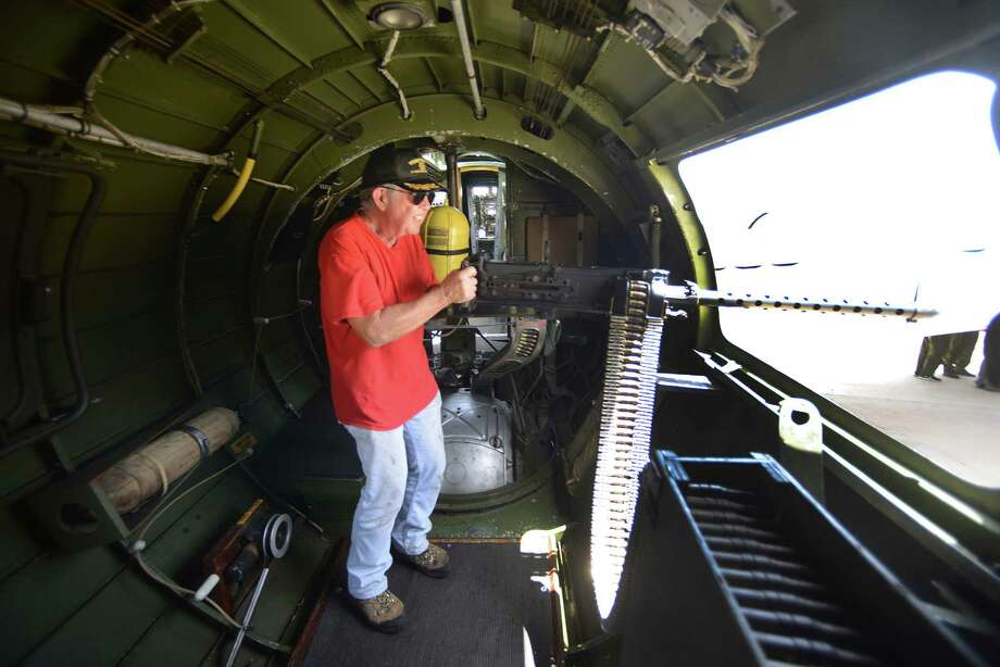 """Dennis Kwiecien mans a machine gun in the B-17G """"Texas Raiders"""" at San Antonio International Airport on Friday, Aug. 9, 2013. The World War II-vintage bomber will be visiting San Antonio August 9-11. It is finished in the colors of the 381st Bomb Group of the famed U.S. 8th Air Force. The B-17 is part of the 381st  Memorial Association veterans reunion this weekend. The airplane will be open to the public for tours and flights.  The vintage bomber is owned by the Commemorative Air Force (CAF), and operated by the Gulf Coast Wing of the CAF located in Spring, Texas.  There are nine flyable B-17s left in the world today. Photo: Billy Calzada, San Antonio Express-News / San Antonio Express-News"""