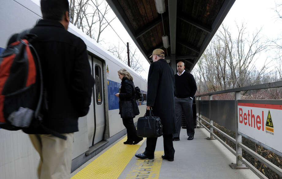 Commuters board a Metro-North train at the Bethel train station in November 2011. Photo: Carol Kaliff