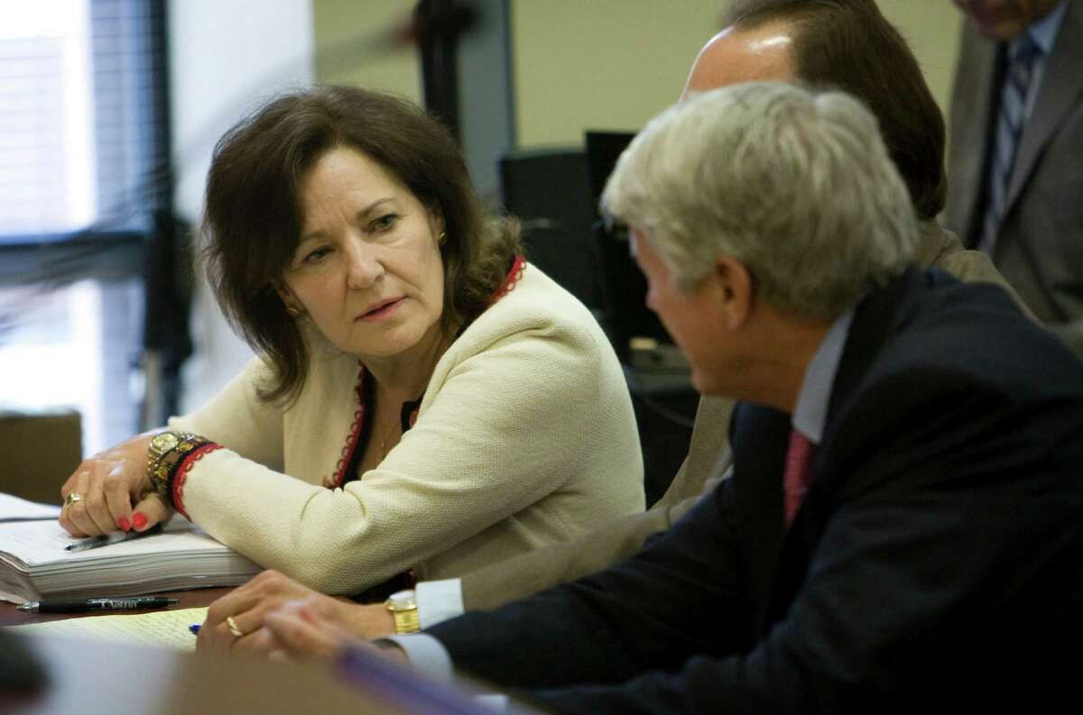 Judge Sharon Keller, left, talks to her counsel before her hearing at the State Commission on Judicial Conduct at the Reagan State Office Building in Austin, Texas on Friday, June 18, 2010. Keller has put her career in the hands of a board deciding whether to remove her from the bench for closing her court before a death row inmate's attorneys filed a last-minute appeal. (AP Photo/Austin American-Statesman, Jay Janner) MAGS OUT; NO SALES; TV OUT; INTERNET OUT; AP MEMBERS ONLY