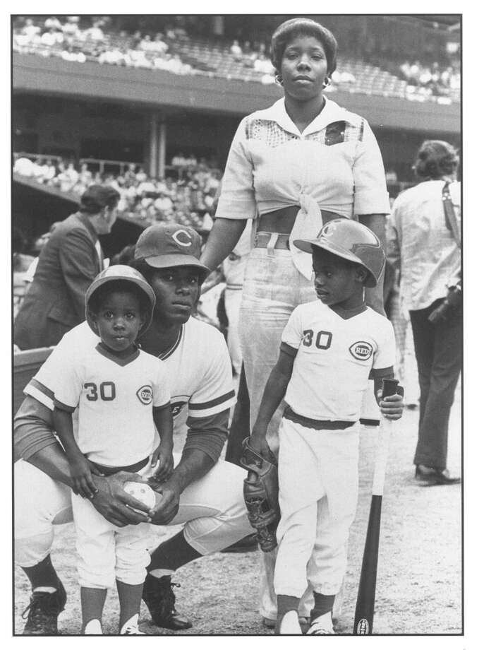 Ken Griffey Jr. has always been known as ''The Kid,'' but here he's an actual kid. In this 1975 photo, the Griffey family poses at Cincinnati's Riverfront Stadium, where dad Ken Griffey Sr. played for the Reds. Junior is the kiddo at right, holding the bat. His mother, Alberta, stands behind as Ken Sr. holds little brother Craig.