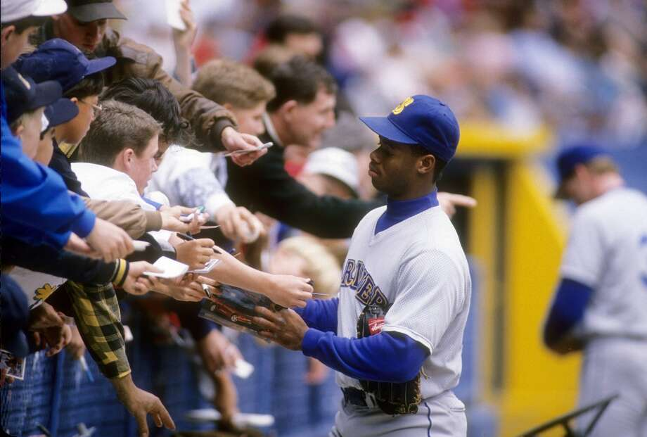 The Kid didn't exactly like signing autographs, but he did it from time to time. In this 1990 photo, he signs autographs while on the road in Cleveland.