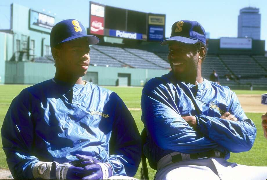 In 1990, Ken Griffey Sr. joined his son in Seattle, both playing in the outfield. Dad was 40 and son was 20. Here they are before a game against the Red Sox at Fenway Park in Boston.  Photo: Focus On Sport, Getty Images