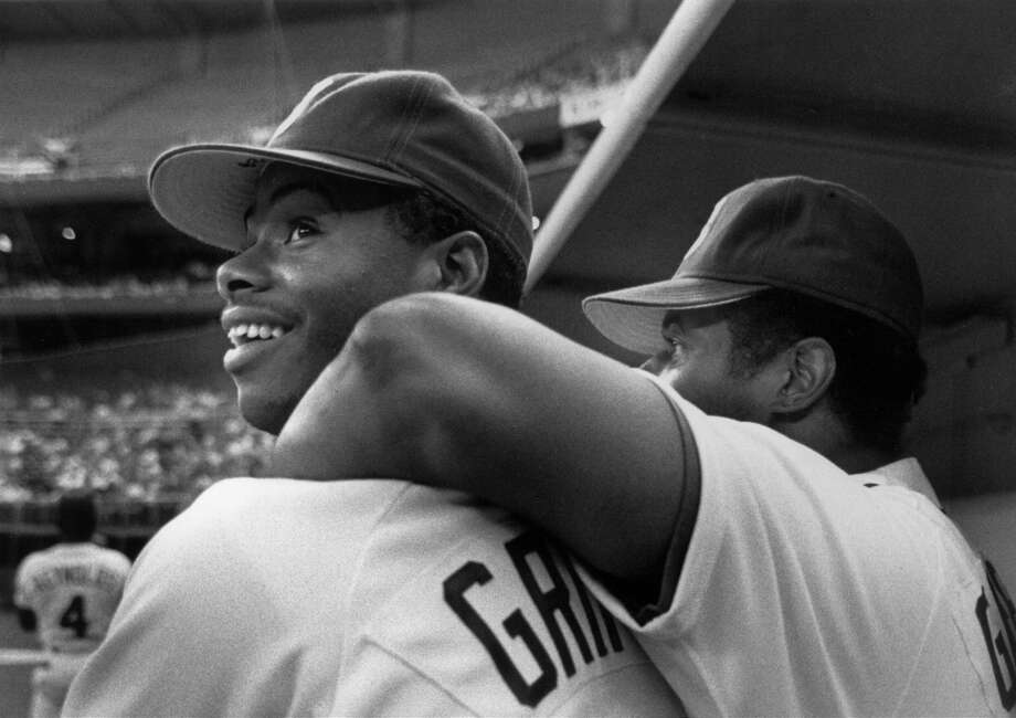 The Griffeys -- Ken Jr. at left, Ken Sr. at right -- soak up the Kingdome atmosphere on Sept. 25, 1990, in Seattle.