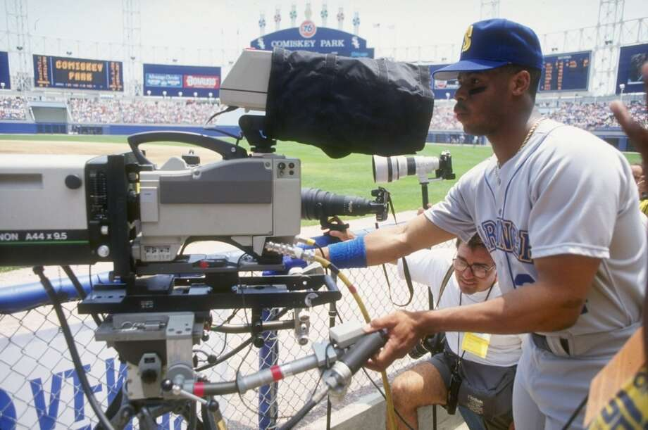 Junior goofs around with a television camera before a 1991 game at Chicago's Comiskey Park.