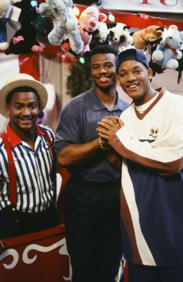 Alfonso Ribeiro, left, and Will Smith, right, pose with Griffey during filming of the ''Fresh Prince'' episode ''Love Hurts.''