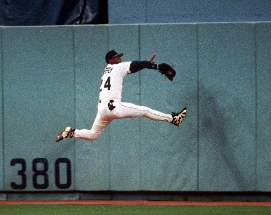 Many Mariners fans likely cringe when they see this photo showing the moment before Griffey collided with the Kingdome's center field wall on May 26, 1995. Griffey broke his wrist and missed much of the season, not returning until mid-August -- when he came back en force and helped his team surge into the postseason for the first time in Mariners history.  Photo: Gary Stewart, Associated Press