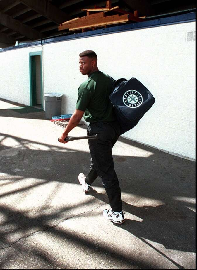 Ken Griffey Jr. flashes a look over his shoulder at a fan who called his name as he walked into Tacoma's Cheney Stadium on Aug. 11, 1995.  Photo: Tom Marks, Seattle P-I Archives