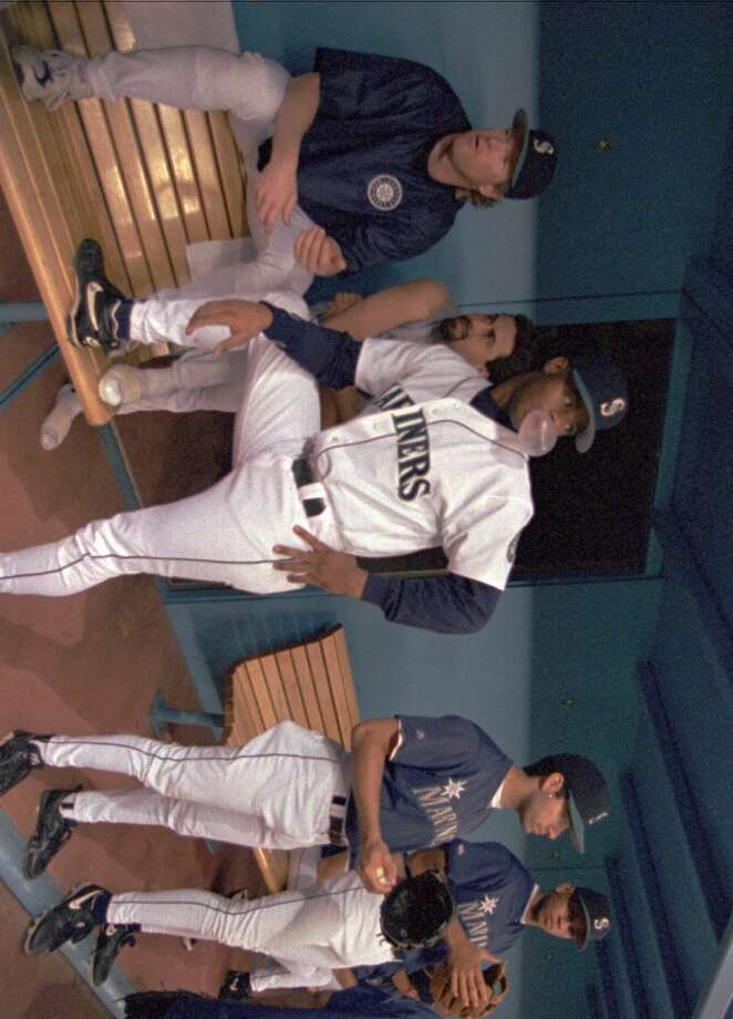 Back in Seattle, here Griffey watches during warmups prior to the Mariners' one-game playoff with the California Angels to determine the 1995 A.L. West champion. The M's won 9-1 on Oct. 2, 1995, and advanced to the postseason for the first time in franchise history.
