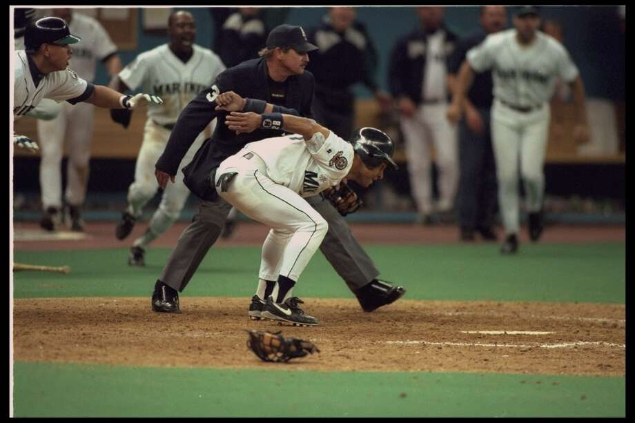 This and the following series of images shows Griffey's famous slide into home Oct. 8, 1995, as he scored from first on ''The Double'' hit by Edgar Martinez. In this first photo, Joey Cora signals for the oncoming Griffey (out of frame) to slide.