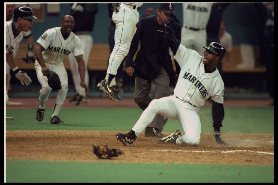 Griffey makes his famous slide to win the fifth and deciding game of the A.L. Division Series against the New York Yankees on Oct. 8, 1995.