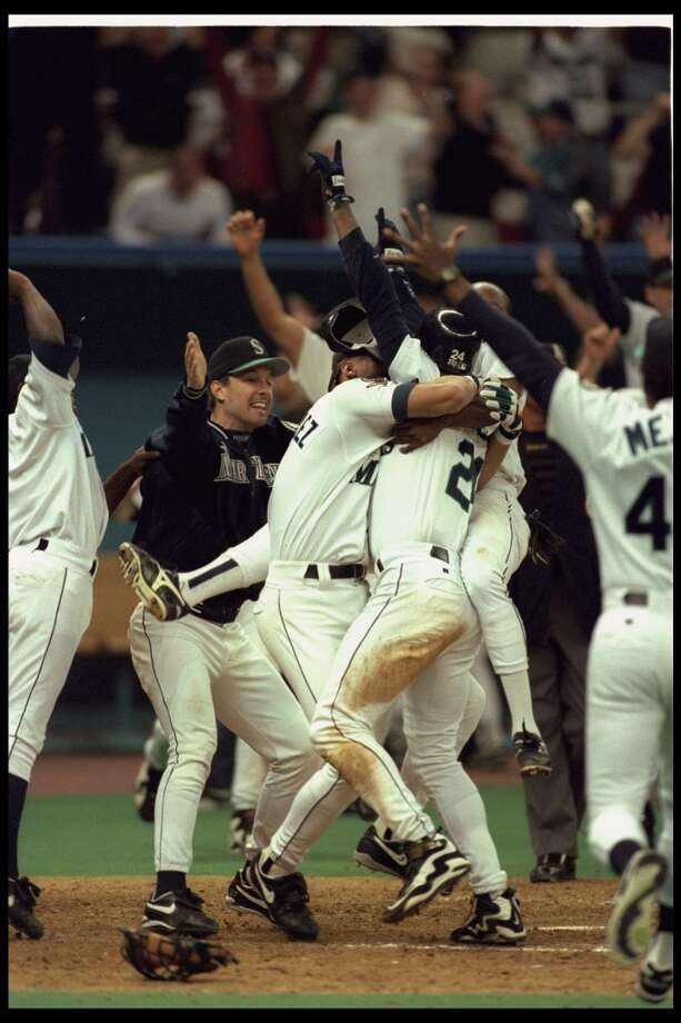 Mariners swarm Griffey after he scored the winning run in the 1995 ALDS.