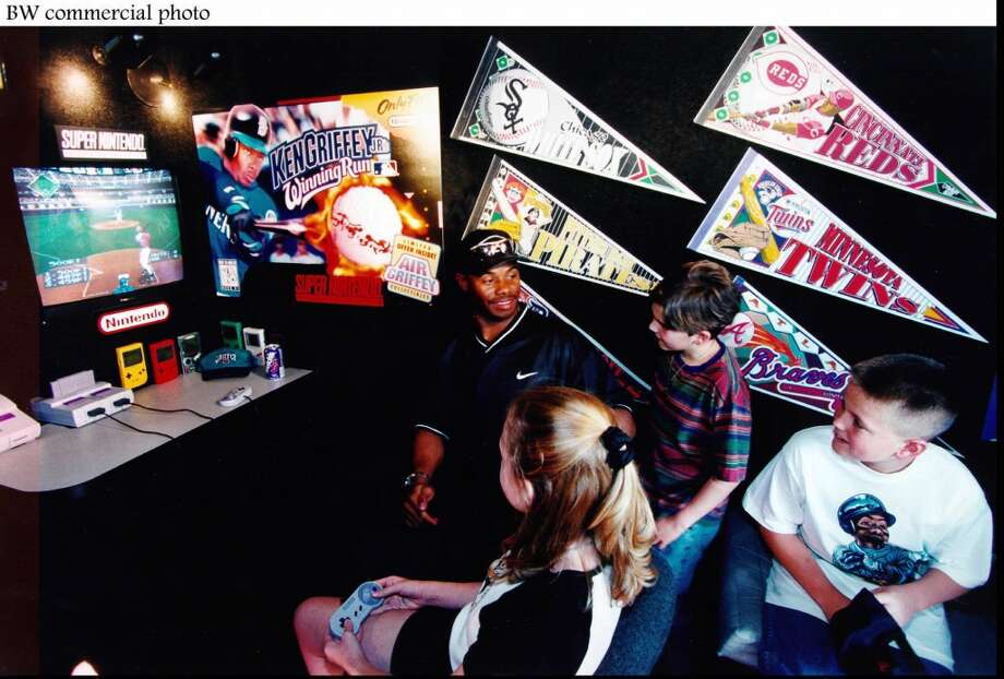 Griffey takes a break from spring training to play a Super Nintendo game -- ''Ken Griffey Jr.'s Winning Run'' -- with local children on the video-game company's Spring Training Van in Arizona on March 12, 1996.