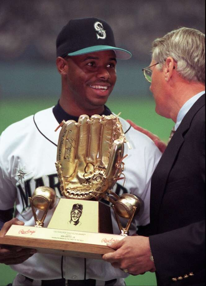 M's president Woody Woodward gives Griffey his Gold Glove award before Opening Day on April 2, 1996, in Seattle.