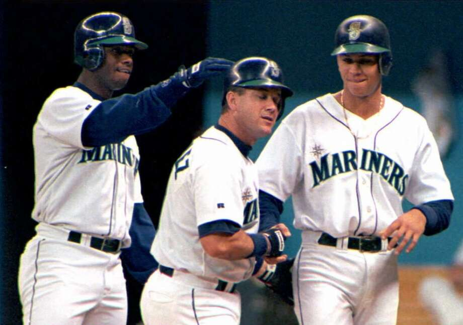 Griffey contratulates Edgar Martinez, center, after Edgar brought him and Alex Rodriguez home on a three-run shot against the Yankees on May 26, 1996, in Seattle.