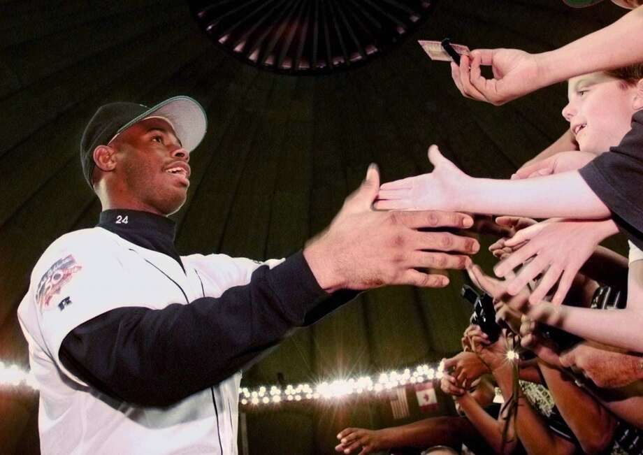 Junior greets fans before the Mariners play the Royals on July 20, 1997, at the Kingdome in Seattle.